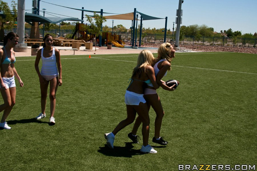 Busty girls playing football