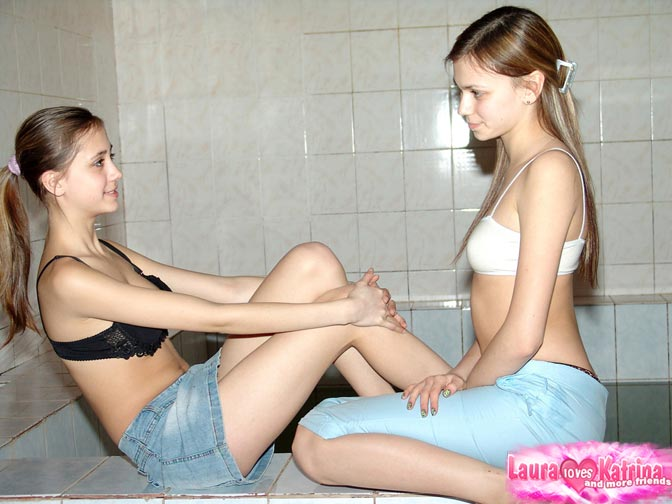 Two young lesbian teens play with each other on cam 9